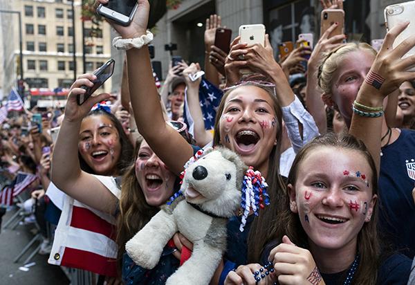 Young fans celebrate U.S. Women's Soccer team