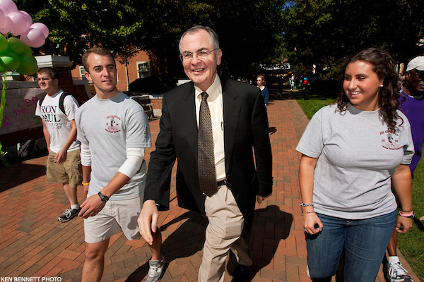 Dr. Hatch walks with students during Hit the Bricks on the Quad